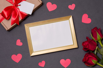 Valentines day,empty frame,black background, gift,red roses,hearts,message,free copy text space
