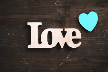 """word """"love"""" on rustic wooden background"""