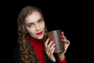 Beautiful girl holds big brown jar of coffee