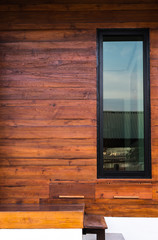 glass window and wood wall