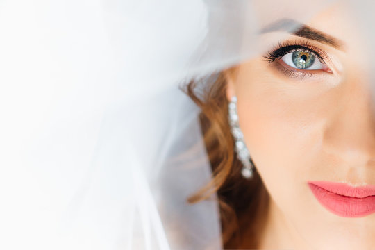 Close-up of the face of the bride's face with make-up and bridal
