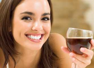 Young woman with glass of redwine