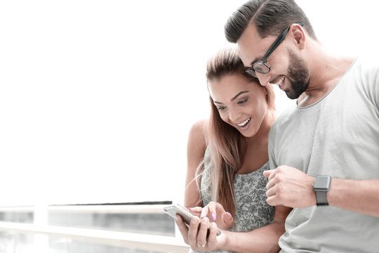 close up.a couple in love discussing video on a smartphone
