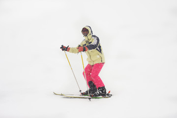 Active sporty woman skiing at winter mountains wit lot of snow
