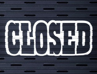 white Closed word on black shutter door wall background.