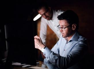 businessman working with documents dark office