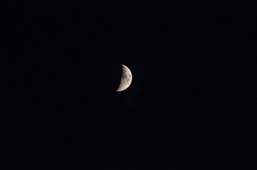 Moon in the night sky. Night sky with a month