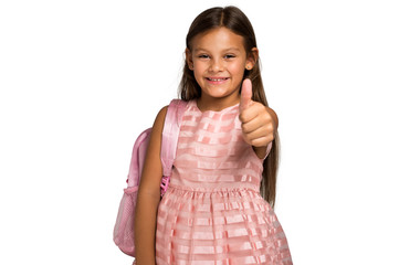 Little smiling school girl with making ok sign
