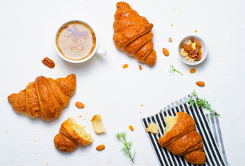 Freshly Baked Croissants and Coffee Cup on White Background