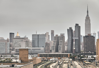 Retro toned picture of New York City skyline on a rainy day, USA.