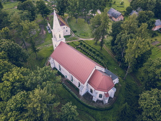 Aerial Photo of an Old Lutheran Church in Countryside Between Trees in Early Spring on Sunny Day, Close up - Concept of Harmony and Religion