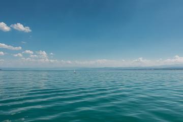 Nice little sailboats on a lake near the coast
