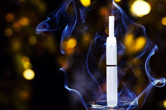 electronic smoke device gold bokeh nobody