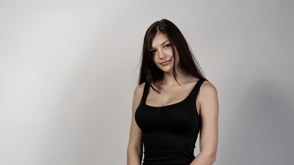 beautiful girl white background black hair and t-shirt