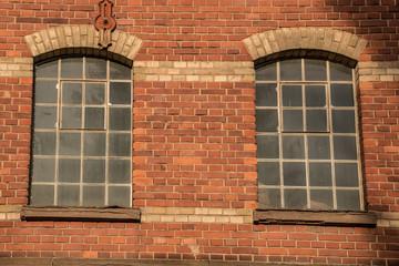 Old empty brick house factory with dark windows