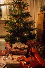 Decorated Christmas tree with Christmas tree balls, candlelight and gifts