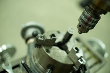 Lathe machine for metal cutting, machinery center background.