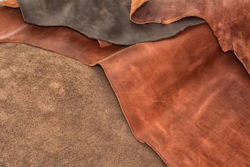 Texture of pieces brown leather. Natural material background.