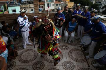 Revellers participate in the traditional celebration Folia de Reis (Kings' party), to celebrate the arrival of the Three Wise Men in Santa Marta slum in Rio de Janeiro