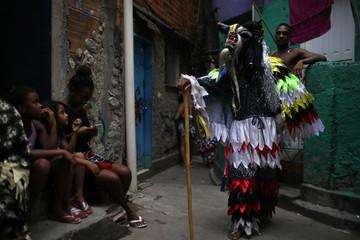 A reveller participates in the traditional celebration Folia de Reis (Kings' party), to celebrate the arrival of the Three Wise Men in Santa Marta slum in Rio de Janeiro