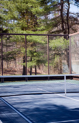 platform tennis paddle court  woods in suburban setting private club called paddle or paddle tennis