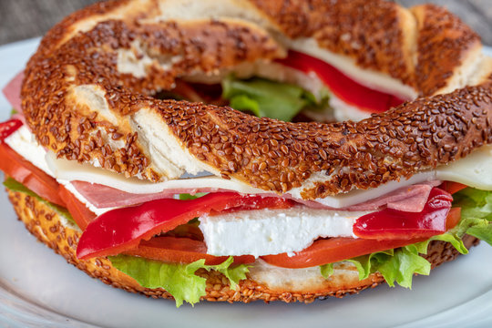 Turkish Bagel Simit Sandwich with cheese, tomato and cucumber.
