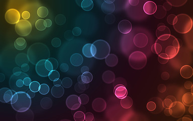 Glowing colorful bubbles on a dark background