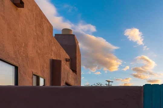 Clouds and blue sky from  the patio of a southwestern adobe building.