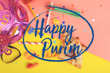 Purim background with carnival mask, party costume and hamantasc