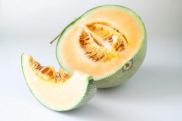 Half and slice Japanese melons or orange melons. Healthy fruit