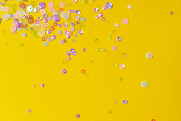Small multicolored sequins as backgroun