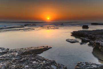 Vibrant Rocky Beach Sunrise Seascape