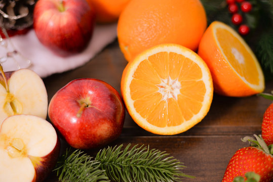 Citrus fruits on wooden background on rustic background ,oranges, strawberries , mandarins, clementines , apples . Healthy eating and dieting concept. Winter assortment