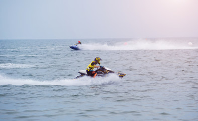 Young guy riding on the jet ski in gulf of Siam