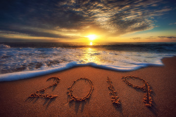 Happy New Year 2019 concept, lettering on the beach. Sea sunrise