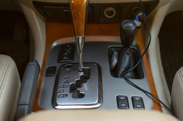 Automatic transmission control console and car interior are close up