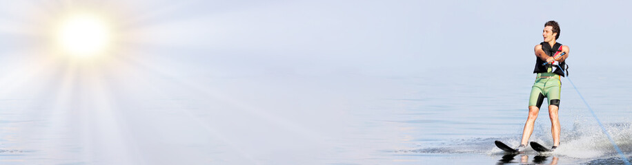 Summer active sport. Man rides on water ski on waves at sunny day. Panoramic wiev. Space for text