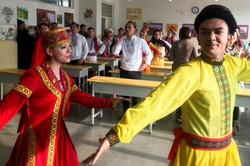 Residents at the Kashgar city vocational educational training centre dance for visiting reporters and officials in a classroom during a government organised visit in Kashgar