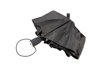 closed black man umbrella on a white background