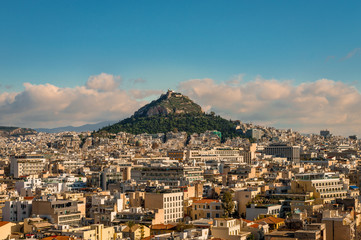 Panoramic view of the Athens` skyline with the Lycabettus Mount, seen from Anafiotika neighborhood, in northerneast side of the Acropolis hill. Athens, Greece, December 2018.