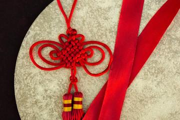 Bright red endless knot traditional tibetan buddhism symbol