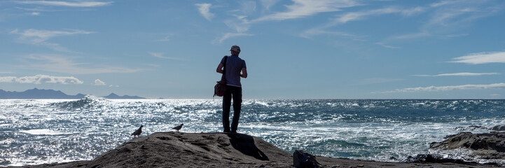 Man looks at the sea at Fuerteventura. Canary Islands