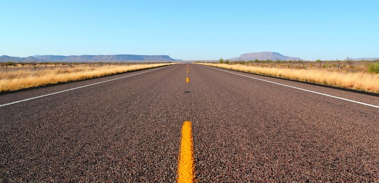 Endless open straight road in Big Bend National Park in Texas
