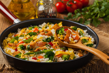 Nasi goreng. Fried rice with egg and vegetables.