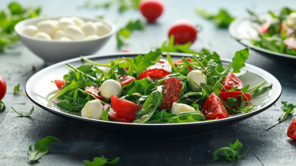 Chorizo salad with cherry tomatoes, mozzarella and wild rucola