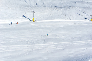 A skier is skiing on snow at a ski resort in the mountains. Winter landscape