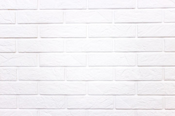 White wall of light brick, background with white brick.