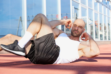 Man doing sit-up workout in outdoor gym