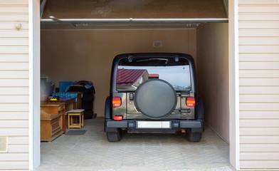 Modern car in the garage. 3D rendering.