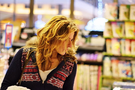 woman shopping in bookstore